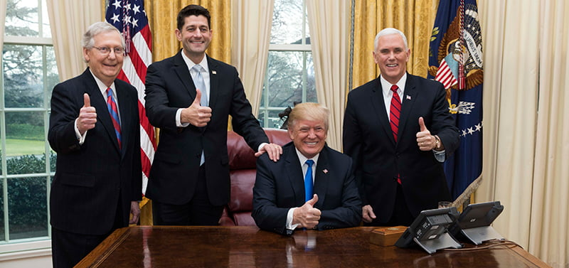 Trump and team celebrate the passage of the Tax Cuts Act