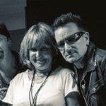 SAV's Nadia Solovieva and Vladimir Zubitsky with U2 during the band's 2010 Russia show