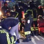Firemen attend to victims of the Lanterna Azzurra crush