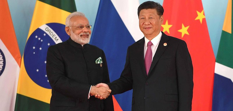 Indian PM Narendra Modi and PRC general secretary Xi Jinping in happier times