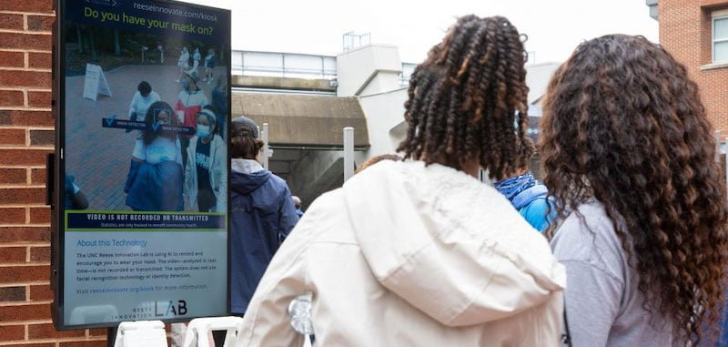 Health Greeter Kiosks identify two mask-wearing UNC fans