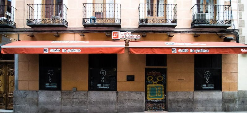 Madrid's Cafe La Palma displaying The Last Concert campaign posters