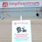 Signage welcoming patients to the Merkur Spiel-Arena vaccination centre