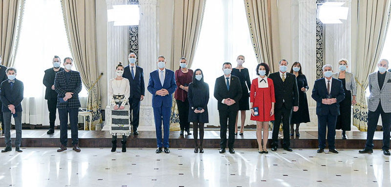 Vulcu (centre, in black dress) with Iohannis and other recipients