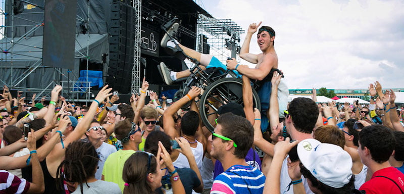 A music fan crowd surfs in his wheelchair during VELD Music Festival in Toronto at Downsview Park August 5, 2012